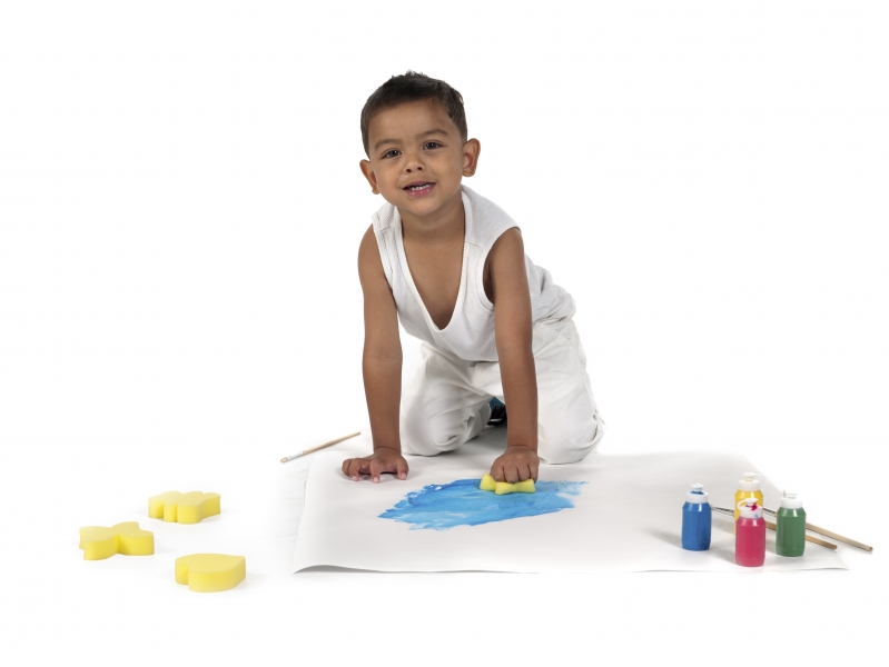 4354551-portrait-image-of-a-boy-doing-painting