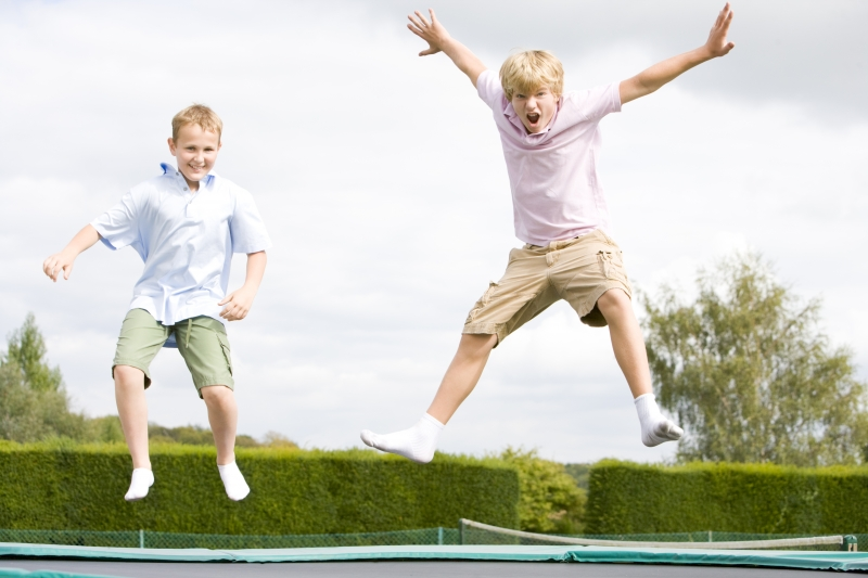2165881-two-young-boys-jumping-on-trampoline-smiling